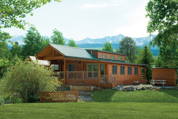 luxurious log cabin finished by ramiro ponce of absolute quality painting for exterior paint color