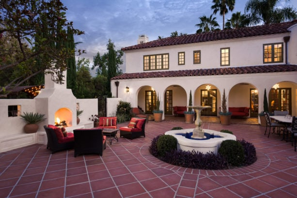 large tuscan style courtyard in a two-story colonial spanish home