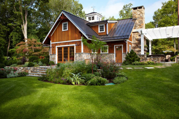 stunning house color combination of stained cedar shakes siding and metal roof