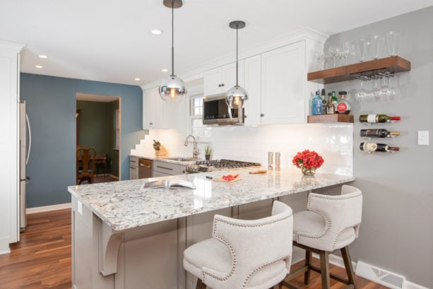 multicolored quartz countertops kitchen peninsula with modern upholstered stools seating