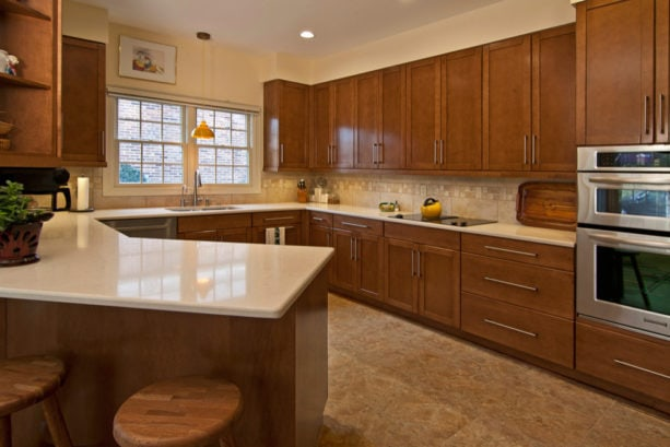 """beige floor and sherwin williams """"cachet cream"""" kitchen color combined with brown shaker cabinets for a nice and warm look"""