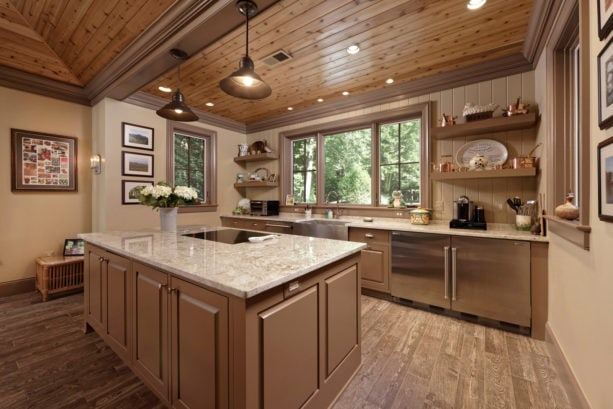 beige kitchen color mixed with light brown raised-panel cabinets to achieve a homey feeling