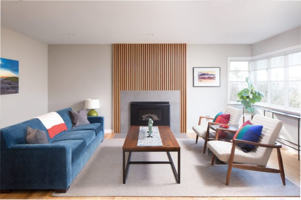 combination of a metal fireplace with vertical wood slat wall surround