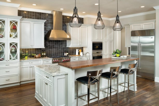 combination of granite and wood countertops in a two-level kitchen island