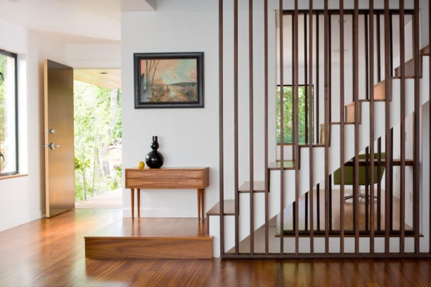 contemporary staircase with dark brown vertical wood slat wall