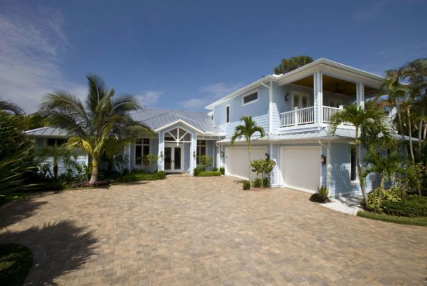 a tropical light blue house with white trim
