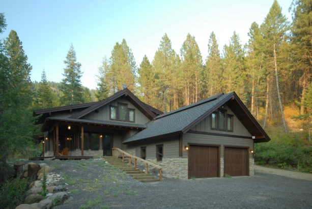 classic green-wood exterior house with chocolate brown trim