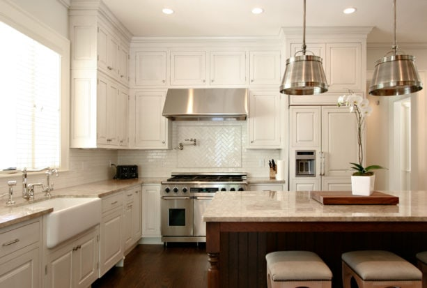 white subway tile with antique white grout for the backsplash in a traditional kitchen
