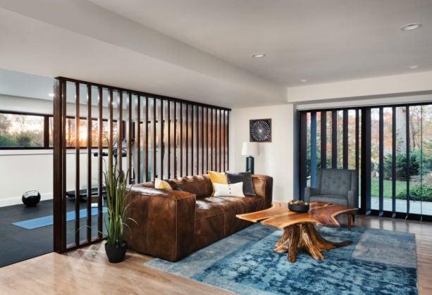 beige floor basement with vertical wood slat wall room divider