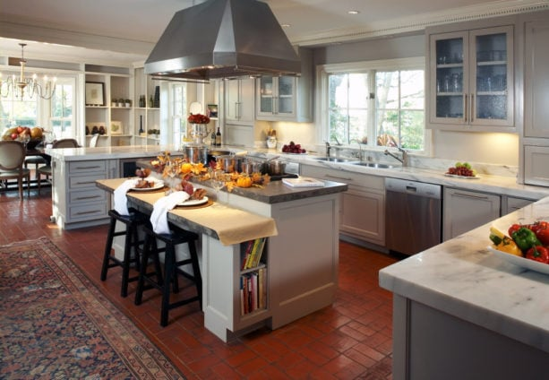 small two-level kitchen island with marble countertops