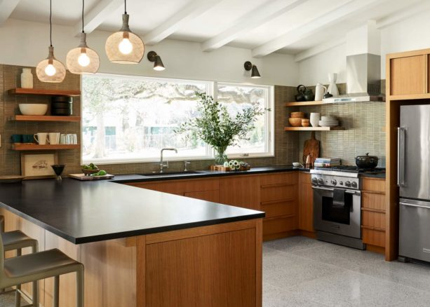 black countertops and green backsplash kitchen color combined with brown flat-panel cabinets for an elegant yet refreshing look