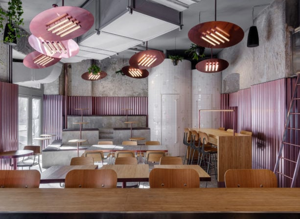 bar interior dominated with pink corrugated metal walls