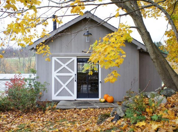 white and gray double x brace single sliding exterior barn door for a home office