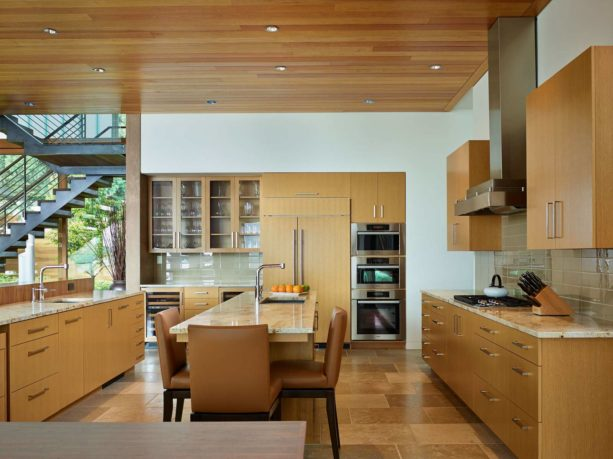 a contemporary kitchen with rift white oak cabinets, stainless steel appliances, and benjamin moore white dove wall paint