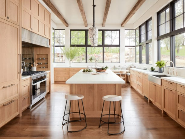 white oak shaker floor to ceiling cabinets with light wood finish