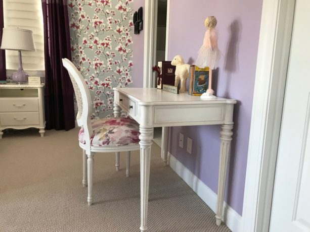 a beautiful white desk and chair in a side of the gorgeous room