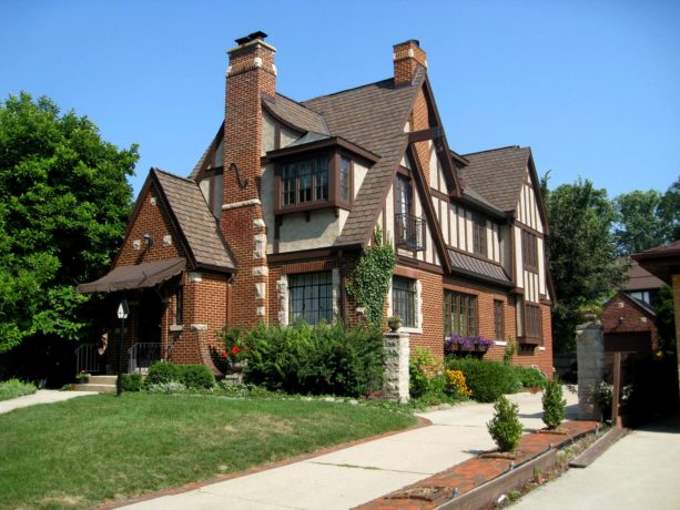 a victorian brown brick house with brick roof