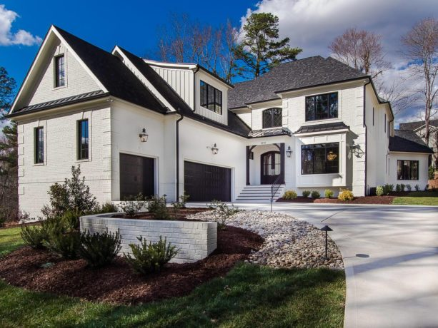 the pairing between white painted brick and black roof shingle in a transitional exterior