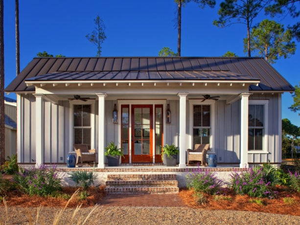 custom color house exterior with white trim and medium bronze metal roof combination