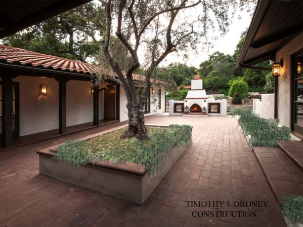 old california mission style home and a courtyard with spanish style outdoor fireplace