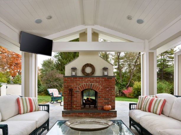 flagstone covered patio with brick wood burning fireplace