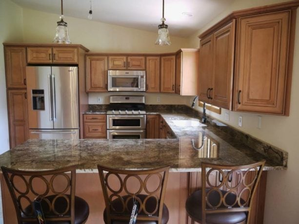 granite countertops kitchen peninsula with country cottage stools seating