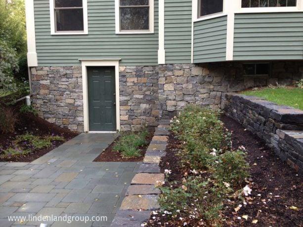 dark green hinged walkout basement door option with white trim