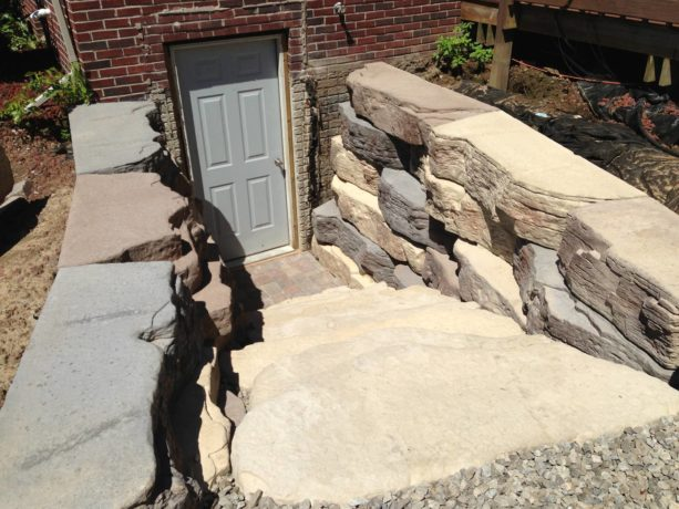 gray hinged walkout basement door option for a rustic exterior