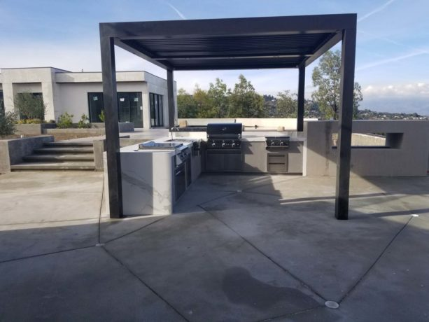 l-shaped modern design outdoor patio kitchen covered with dark metal structure
