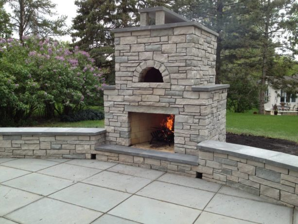 outdoor stone fireplace with built-in pizza oven