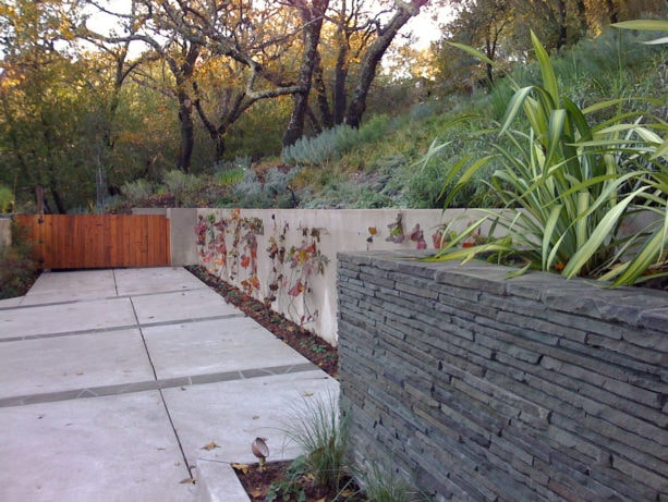 ideas to stabilize steep slopes with stacked bluestone retaining wall