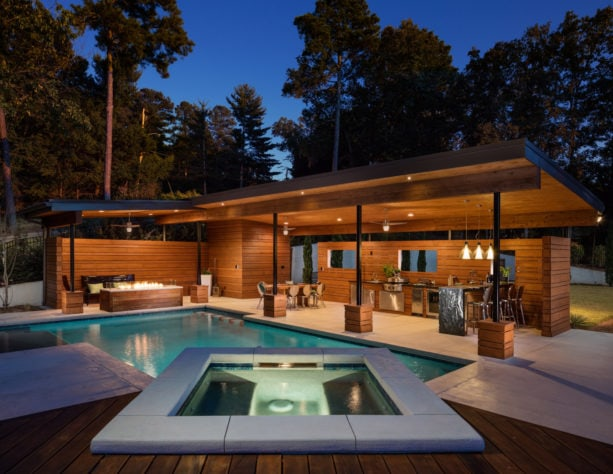 a large modern backyard with stamped concrete, pool, and spa