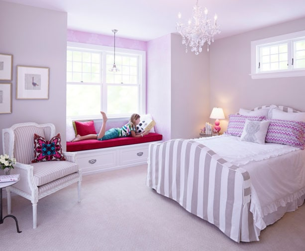 a soft purple and white traditional girl's bedroom with a bold magenta pink touch