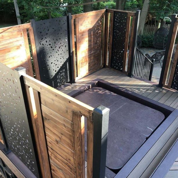 laser cut privacy screens paired with horizontal wood wall for the built-in hot tub in the deck