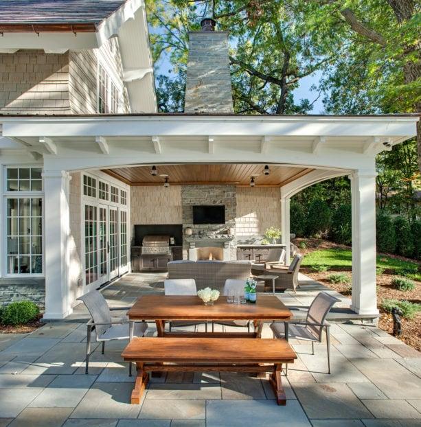 bluestone covered patio with bluestone veneer fireplace