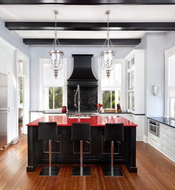 black island with red quartz top for adding elegance in your kitchen