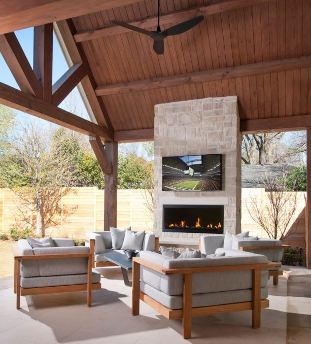 contemporary limestone covered patio with linear firebox fireplace