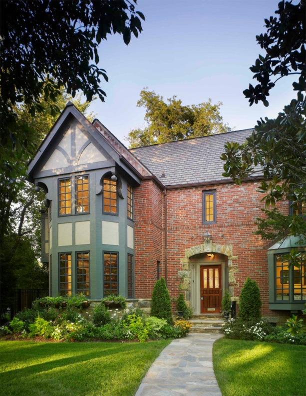 sage green paint color to create a complementary look in red brick exterior