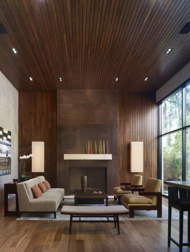 minimalist open concept living room with vertical wood slat wall paneling