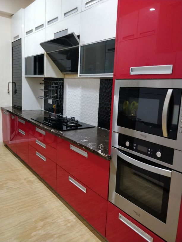 black countertops with white veins for red kitchen cabinets