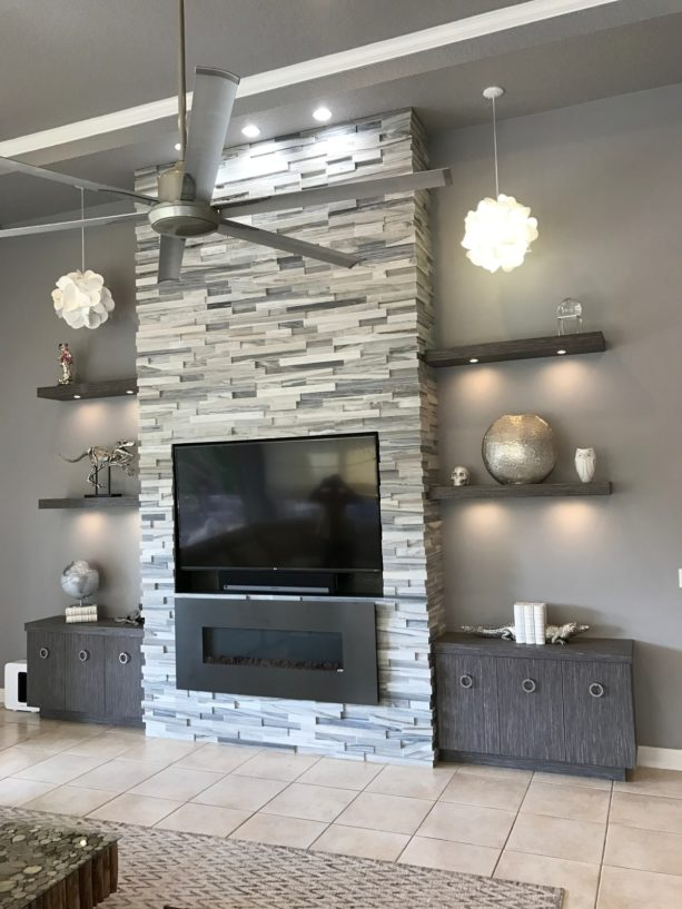 modern wall media unit with fireplace surrounded by cut marble stone