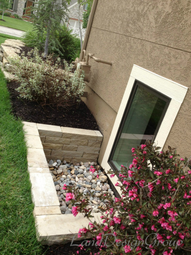 extra-low basement window well made of natural stone