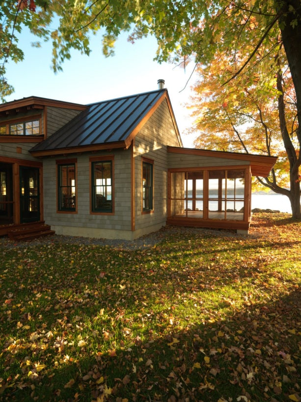 lake cottage green house with metal roof and brown trim