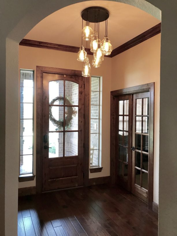transitional small entryway with dark wood flooring