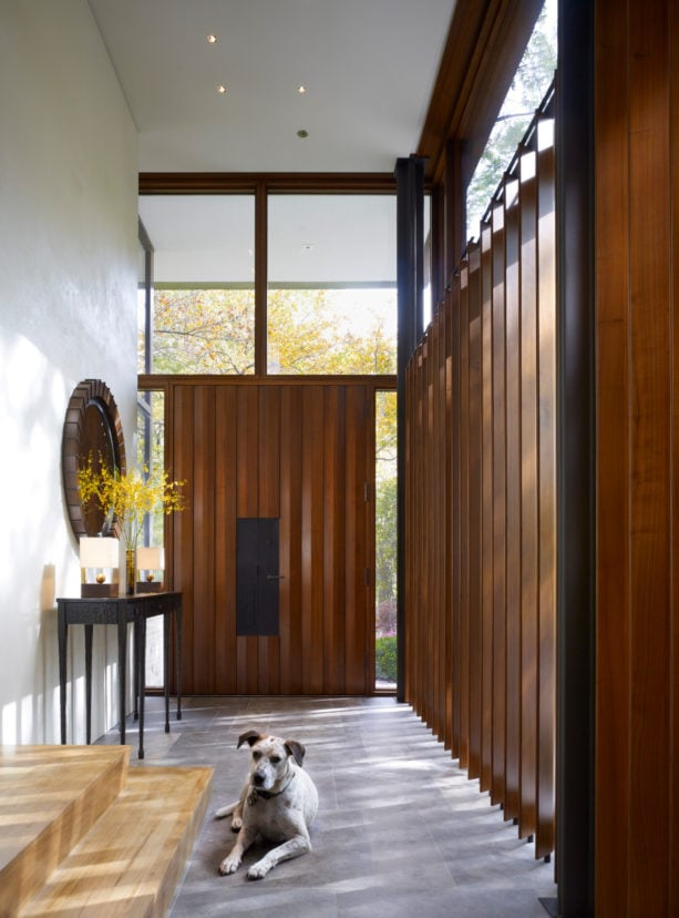enclosed entrance with huge vertical wood slat wall