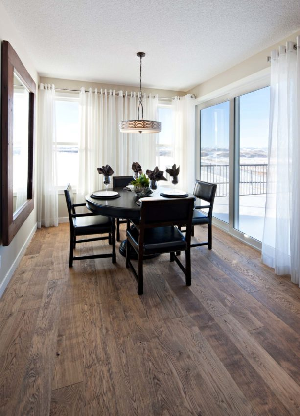 dining room sliding glass doors with chrome rods and sheer curtains