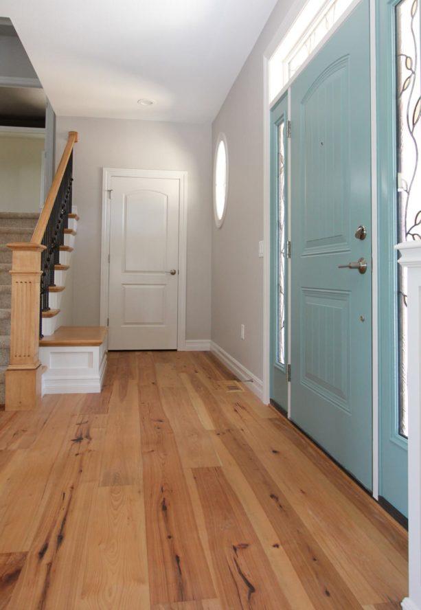 small foyer entryway with hickory flooring idea