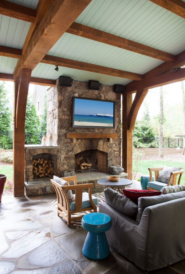 outdoor fireplace with built-in wood storage and tv for mid-sized traditional backyard
