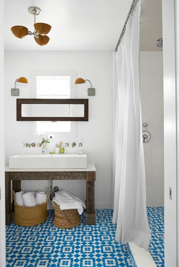 a country bathroom with a perfect combination of graphic blue tile and white wall