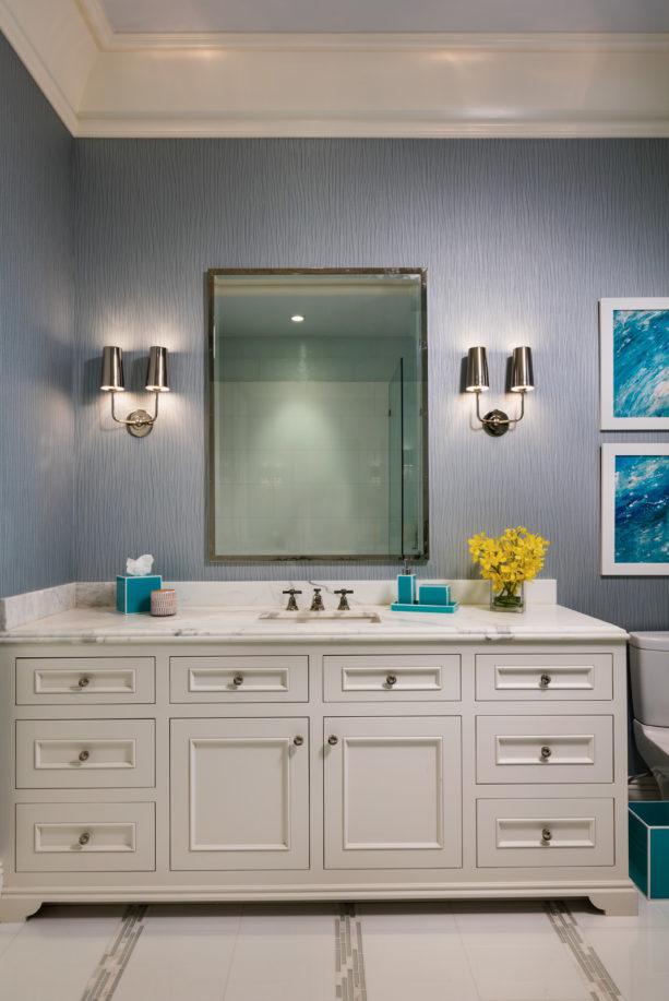 a modern bathroom with Santorini blue and white color scheme